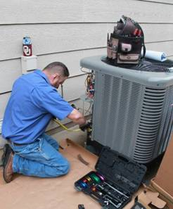 Hanna HVAC technician working on outside broken air conditioner