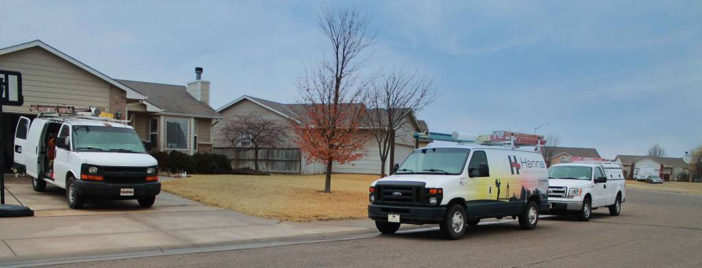 Hanna HVAC vehicles on Wichita street for installation of a new heating and air system