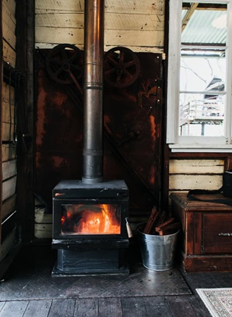 Old fashioned wood fired heat unit in history of home heating