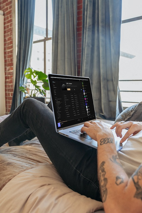 Guy working from home on his bed. Photo by Vollume Control on Unsplash